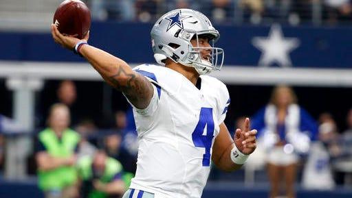 Dallas Cowboys quarterback Dak Prescott (4) throws a pass in the first half of Sunday's game.