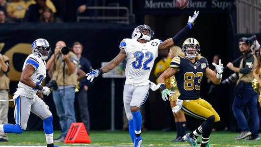 Detroit Lions strong safety Tavon Wilson (32) intercepts a pass intended for New Orleans Saints wide receiver Willie Snead (83) in the second half of an NFL football game in New Orleans, Sunday, Dec. 4, 2016.