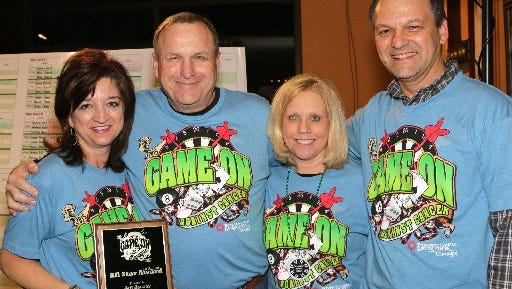 Game On Against Cancer's first-ever All Star Award in 2015 was presented to WNML radio host Jeff Jacoby by Thompson Cancer Survival Center Development Director Gina Williams (left) and Games & Things owners Lisa and Scott Mellon.