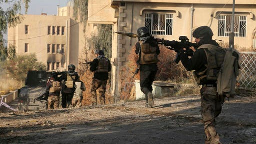 Iraqi special forces advance inside Mosul University grounds, during fighting against Islamic State militants in the eastern side of Mosul, Iraq, Saturday, Jan. 14, 2017.