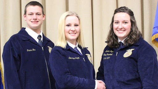 Wisconsin State FFA President Brenna Bays (right) weclomes Freedom FFA members Travis Fox and Sami Angotti at the Half-Time Leadership Conference held in Stevens Point.
