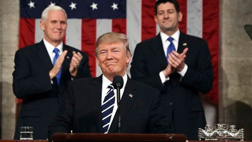President Donald Trump, flanked by Vice President Mike Pence and House Speaker Paul Ryan of Wis., arrives on Capitol Hill in Washington for his address to a joint session of Congress.