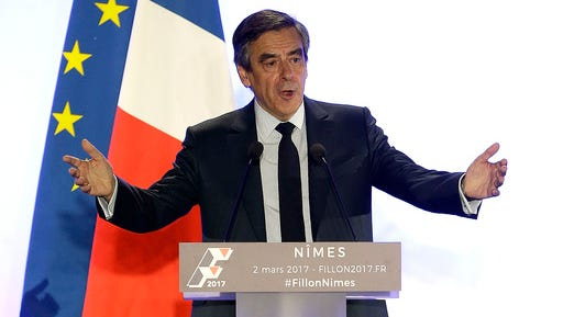 Conservative presidential candidate Francois Fillon delivers his speech in Nimes, Thursday, March 2, 2017. Fillon is refusing to quit the race despite receiving a summons Wednesday to face charges for alleged fake parliamentary jobs for his family.