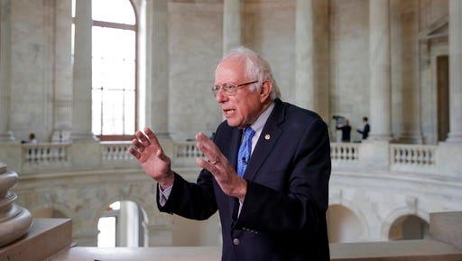 """FILE - In this March 15, 2017, file photo, Sen. Bernie Sanders, I-Vt. gestures during a television interview on Capitol Hill in Washington. House Republicans' health care bill provides massive tax cuts to the wealthy while increasing taxes for many lower income families, adding to America's big income gap between the rich and everyone else. """"This is a massive transfer of wealth from working families to the very richest people in this country,"""" said Sanders. """"In this case, all the people will be forced to pay more for health insurance while billionaires get a tax break."""""""