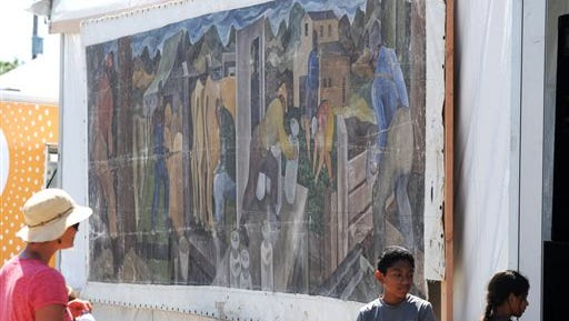 This photo shows a large mural displayed at the Skagit County Fair in Mount Vernon, Wash. Its origin once a mystery, a Seattle art dealer confirmed on Friday that the canvas is an original 1941 painting by William Cumming.