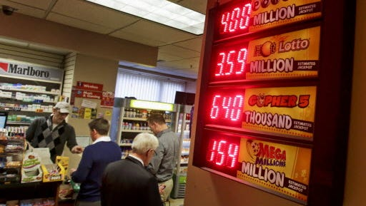 The value of the Powerball jackpot tops the list of lottery payouts in this convenience store in Minneapolis on Feb. 18.