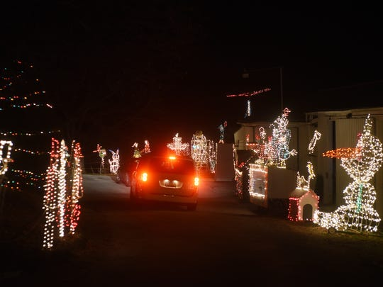 Thurman Drake Sr. has been decorating his Zanesville home with home-made Christmas light displays since the 1960s. Cars can drive through the displays or visitors can get out and walk around.
