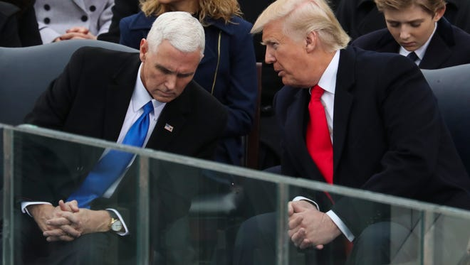 President-elect Donald Trump leans over to talk with Vice President-elect Mike Pence during the 58th Presidential Inauguration at the U.S. Capitol in Washington, Friday, Jan. 20, 2017. (AP Photo/Andrew Harnik)