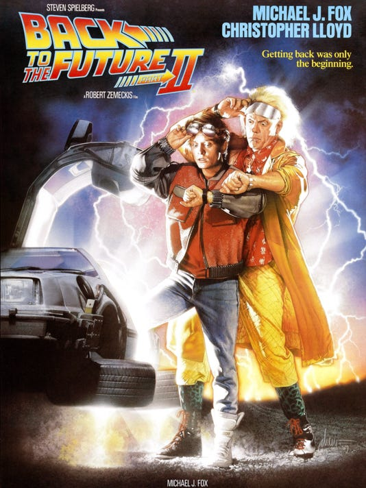 BACK TO THE FUTURE PART II, l-r: Michael J. Fox, Christopher Lloyd on poster art, 1989, ©Universal/courtesy Everett Collection