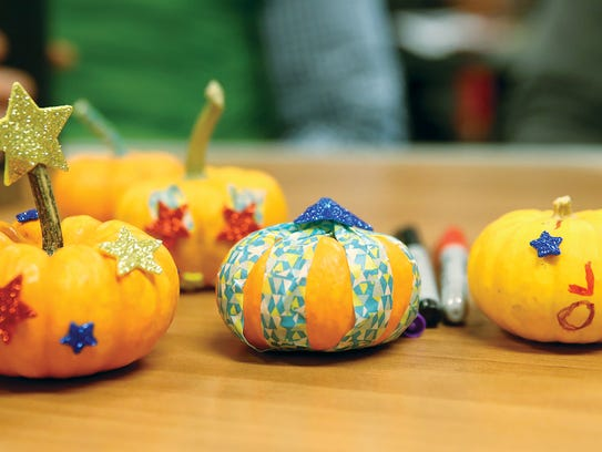 """Rock the Boat,"" ferry commuters finished pumpkin project."