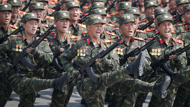 In this April 15, 2017, file photo, soldiers march across Kim Il Sung Square during a military parade in Pyongyang, North Korea, to celebrate the 105th birth anniversary of Kim Il Sung, the country's late founder and grandfather of current ruler Kim Jong Un.
