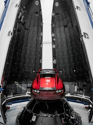SpaceX CEO Elon Musk said this midnight cherry Tesla Roadster will launch atop the debut flight of the Falcon Heavy rocket, targeted for January 2018 from Kennedy Space Center.