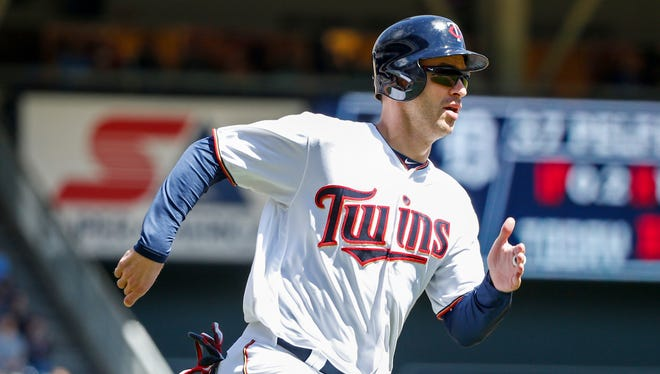 Minnesota Twins first baseman Joe Mauer scores from second base on a single by designated hitter Byung Ho Park in the first inning of a baseball game against the Detroit Tigers, Sunday, May 1, 2016, in Minneapolis. (AP Photo/Bruce Kluckhohn)
