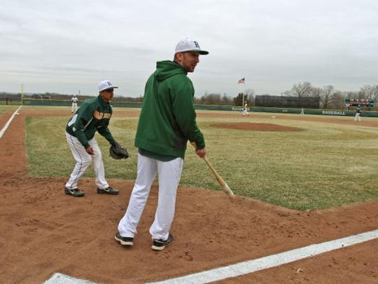 Piscataway Tech baseball coach Nick McKee warms up