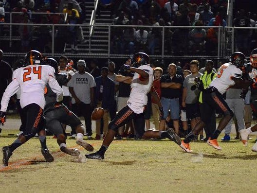 John Smith blocks a punt Friday night in the Tigers home win against Booker T. Washington.