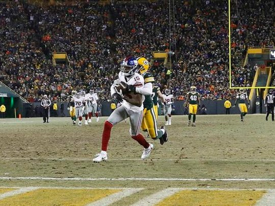 New York Giants wide receiver Tavarres King (15) runs to the end zone for a touchdown against Green Bay Packers cornerback Damarious Randall (23) during the second half of an NFC wild-card NFL football game, Sunday, Jan. 8, 2017, in Green Bay, Wis. (AP Photo/Mike Roemer)