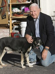 Retired Army Col. Bill Badger, with his dog at his