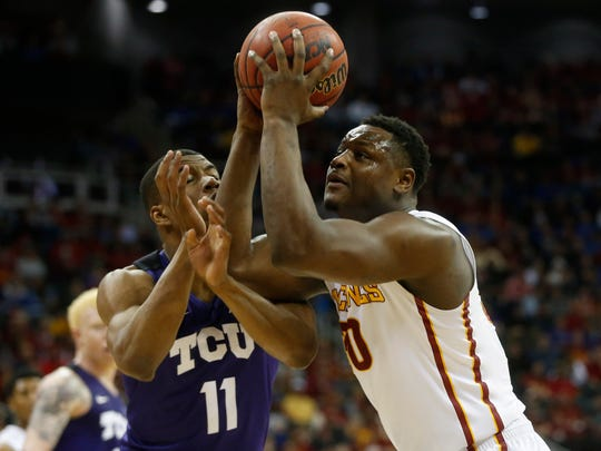 Iowa State guard Deonte Burton (30) takes a shot over TCU guard Brandon Parrish (11) Friday, March 10, 2017 during the semifinals of the Big 12 Men's Basketball Championship in Kansas City.