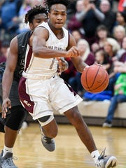 Henderson's Cartel Gilbert drives to the basket followed by Reitz's Tamaje' Blackwell as the Henderson County Colonels play the Evansville Reitz Panthers Tuesday at Colonel Gym, December 13, 2016.