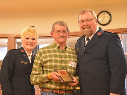 From left, Salvation Army Lt. Terri Olson, Joe Siebold and Lt. Jeff Olson. Siebold was given an award in 2015 for his volunteer service with The Salvation Army - Manitowoc County.