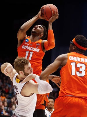 Syracuse's Oshae Brissett (11) scores the game-tying basket against Arizona State's Mickey Mitchell, left, during the second half of a First Four game of the NCAA men's college basketball tournament, Wednesday, March 14, 2018, in Dayton, Ohio. Syracuse won 60-56. (AP Photo/John Minchillo)