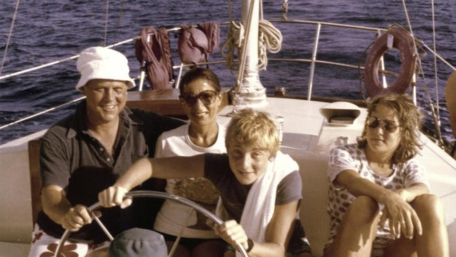 In this image provided by the Supreme Court, Ruth Bader Ginsburg, her husband Martin Ginsburg, and their children Jane and James off the coast of St. Thomas in 1979.