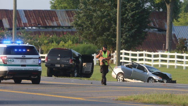Authorities  work a scene, where at least one person is dead after a police pursuit and crash that ended along Highway 231 in Murfreesboro , on Friday, June 24, 2016.