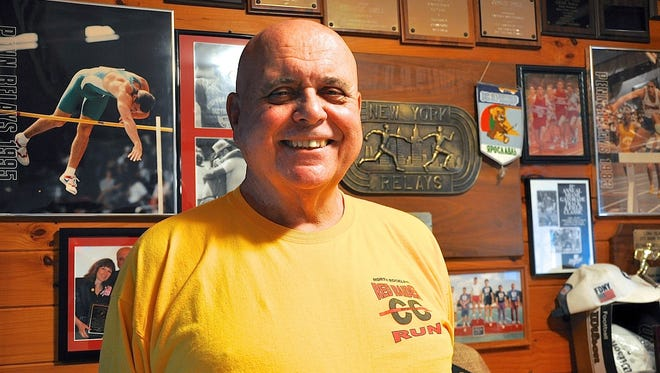 Gene Dall, North Rockland track and field coach, in his Tomkins Cove home, which is filled with years of memories -- much of it displayed on the walls..jpg