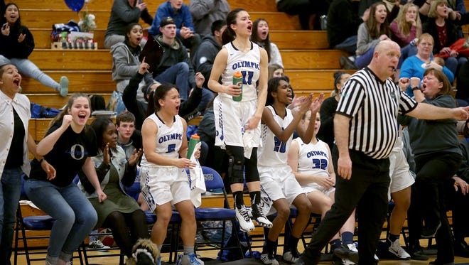 Olympic's Katie Campana, center, jumps for joy as her teammates celebrate the reserves players scoring late in the fourth period against North Kitsap on Thursday. Head coach Laurie Shaw is on the right, and star player Danielle Monzon is on Campana's, left,.