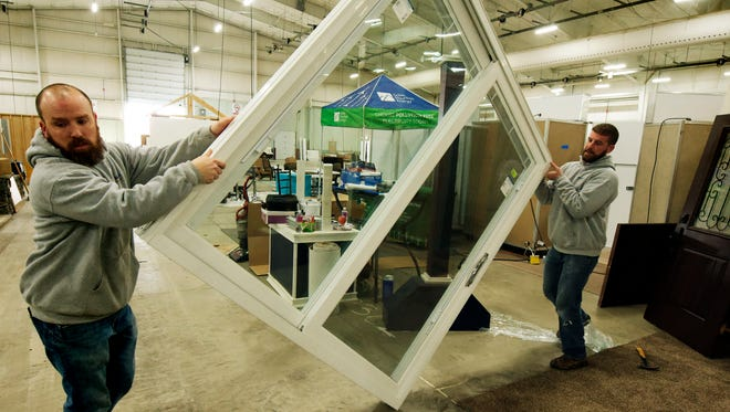 HomeRite Windows, Doors & more co-owners Andy Matter, left, and Kyle Barder move a sliding door while preparing the company's display for the York Builders Association Home and Garden Show Thursday, Feb. 8, 2018. HomeRite is based in Harrisburg. The show will feature landscape displays, product demos and activities for children. It runs runs Friday from 1 p.m. to 8 p.m., Saturday 10 a.m. to 8 p.m. and Sunday 11 a.m. to 4 p.m. Bill Kalina photo