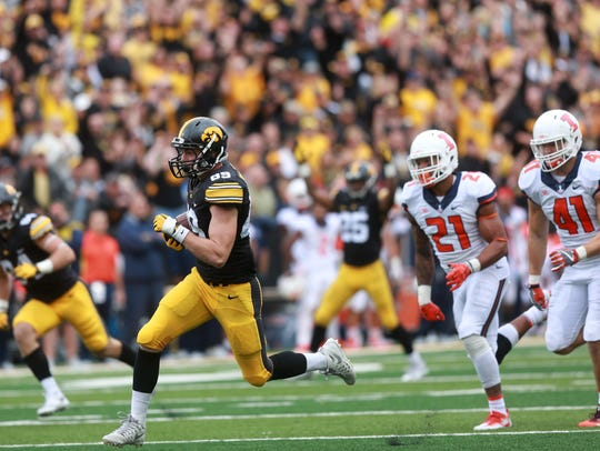 Iowa wide receiver Matt VandeBerg runs down field for