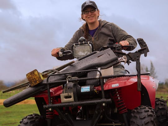 Mickey on ATV: U.S. Army Sgt. Mickey Clayton, Scio, managing Dot Ranch