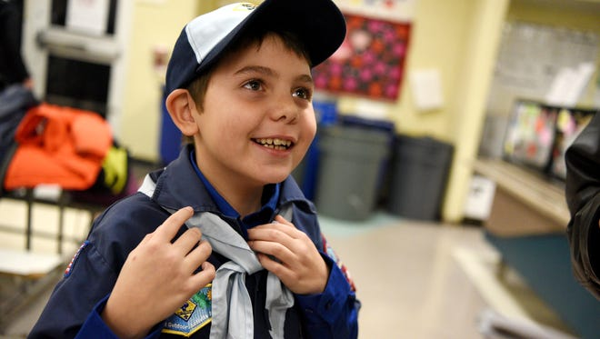 Joe Maldonado, the first openly transgender member of the Boy Scouts of America, proudly shows off the uniform he received from Kyle Hackler, leader of Cub Scouts Pack 20 of Maplewood-South Orange.