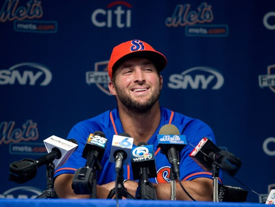 Tim Tebow speaks at a press conference before his scheduled