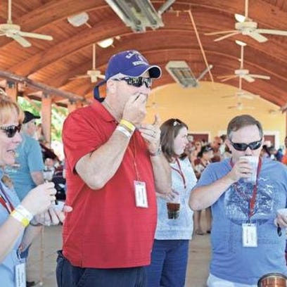 Visitors to the 2015 Palmetto State Chili Cookoff sample