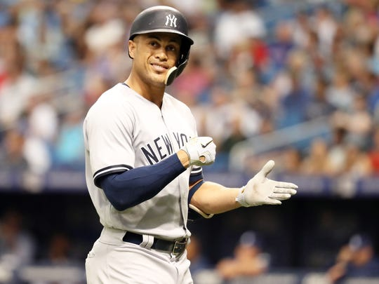 New York Yankees left fielder Giancarlo Stanton (27) reacts as he hits a pop up to left field during the fourth inning against the Tampa Bay Rays at Tropicana Field.