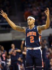 Auburn guard Bryce Brown celebrates after hitting a 3-pointer against LSU during the first half of an NCAA college basketball game Saturday, Jan. 27, 2018, in Auburn, Ala.