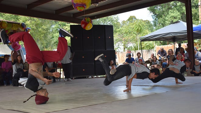 Dancers from Showtime Stars breakdance during the fifth annual Fiesta de La Luz on Saturday afternoon.