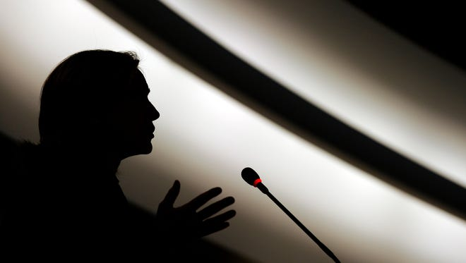 US Secretary of State Hillary Clinton is seen in silhouette while delivering her speech during the opening of the 16th session of the United Nations Human Rights Council focusing on deadly repression in Libya on February 28, 2011 in Geneva. A training session will be held in Kalamazoo to help women run for political office.