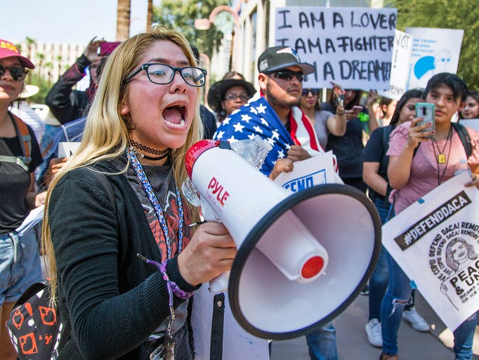Berania Yanez, 16, shouts from a megaphone to other