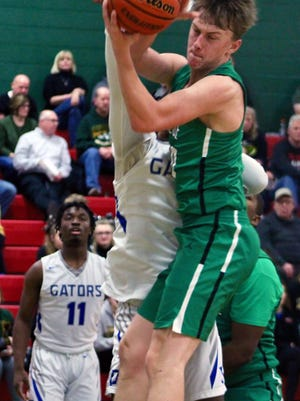Wethersfield's Brady Kelley (20) brings down a rebound against Peoria Quest's Isaiah Brown (1) on Saturday at Abingdon-Avon High School's Dunlap Gymnasium in the Great Western Shootout.
