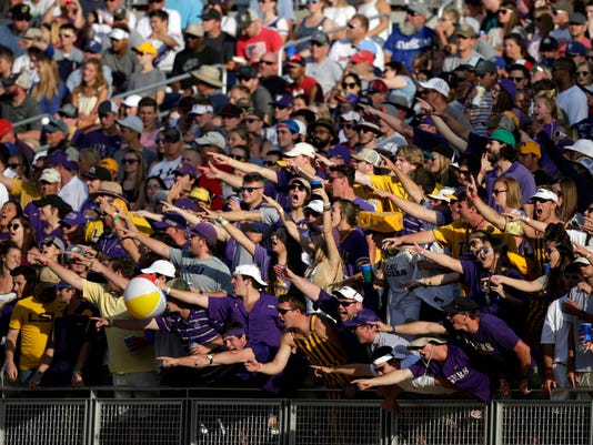 LSU fans cheer during the first inning against Florida in Game 2 of the NCAA College World Series baseball finals in Omaha, Neb., Tuesday, June 27, 2017. (AP Photo/Nati Harnik)