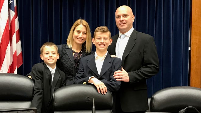 Tammi, Jason, C.J. and Tommy Carr pose for a photo Wednesday, March 29, 2018, in Washington, D.C.