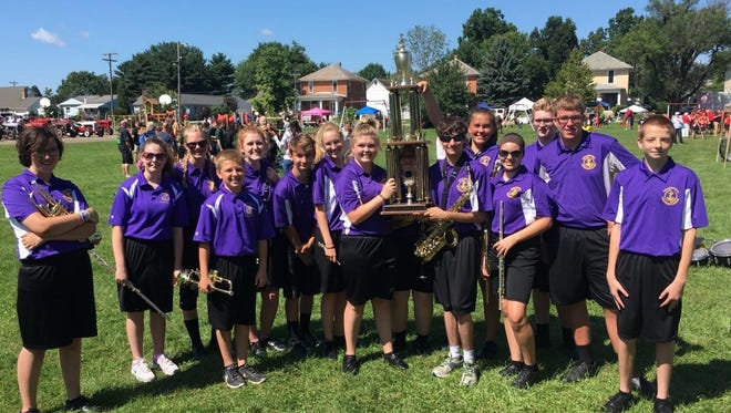 """Millersport High School's Marching Lakers received the trophy for """"Best Marching Band"""" in the Baltimore Festival Parade Competition Saturday, Aug. 5."""