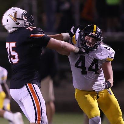 West Des Moines Valley Tigers Jake Remsburg battles