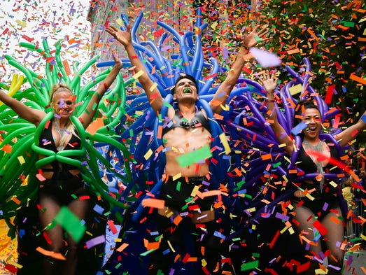 People dance in the annual LGBTQI Pride Parade on June