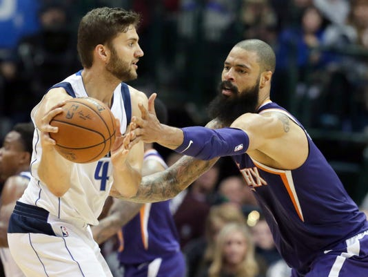 Phoenix Suns center Tyson Chandler, right, defends Dallas Mavericks forward Maximilian Kleber (42), of Germany, during the second half of an NBA basketball game in Dallas, Monday, Dec. 18, 2017. The Suns won 97-91. (AP Photo/LM Otero)