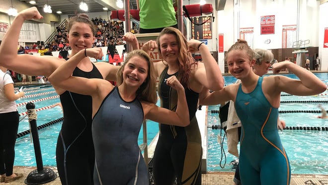 Colonel Crawford's relay swimmers Jillianne Gregg, Kaisey Speck, Pierce Krassow and Cassidy Vogt playfully flex for some of their supporters at the state meet.
