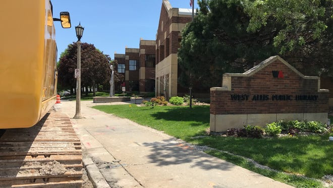 Despite the construction in front of the West Allis Public Library, 7421 W. National Ave., it was the scene of two thefts in three days. The first was at the library entrance where the tall statue can be seen. The other happened at about the construction cone.