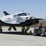 APSierra Nevada Corp. engineers and technicians prepare the Dream Chaser engineering test vehicle at NASA's research center. In this June 27, 2013 photo provided by NASA, Sierra Nevada Corp. engineers and technicians prepare the Dream Chaser engineering test vehicle for tow tests at NASA's Dryden Flight Research Center in California. On Thursday, Jan. 14, 2016, NASA announced the Sierra Nevada Corp. will join SpaceX and Orbital ATK in launching cargo to the International Space Station. These flights, yet to be finalized, will run through 2024. (Ken Ulbrich/NASA via AP)